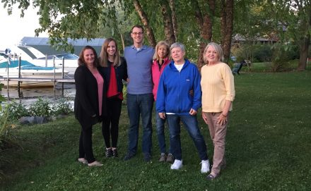 Office staff and family party at Lake Minnetonka